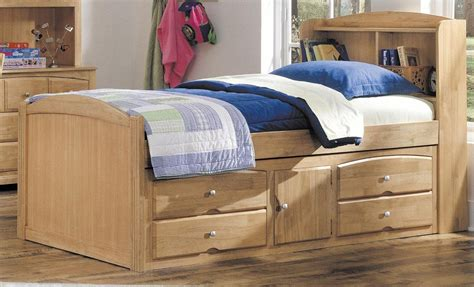 Size Beds With Drawers Underneath by Wooden Size Platform Bed With Drawers And Cabinet Storage Underneath Plus Bookshelves On