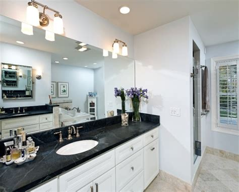 white bathroom cabinets with dark countertops floor tile countertops white ice granite colonial cream