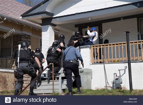 Serving A Search Warrant Tactical Team Serving A High Risk Related Search Warrant Stock Photo