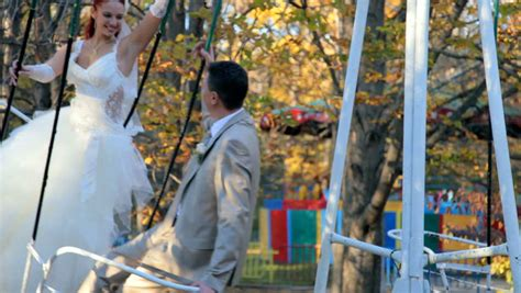 married couples swing happy bride on a swing in autumn stock footage video