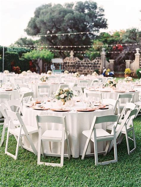guest tables with white resin chairs 66 quot tables with ivory linens and napkins