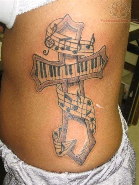 music cross tattoo notes tattoos on rib