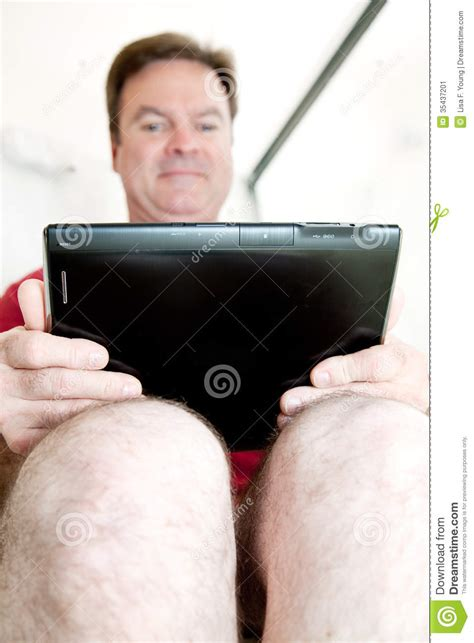 guys using the bathroom using tablet on the toilet stock image image 35437201