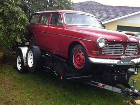 red wagon  volvo  wagon
