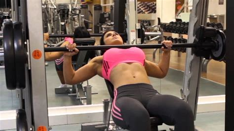 bench press with smith machine smith machine bench press vs barbell bench press