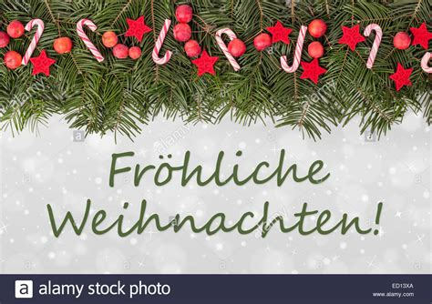 german christmas card  pine green candy canes apples  text stock photo  alamy