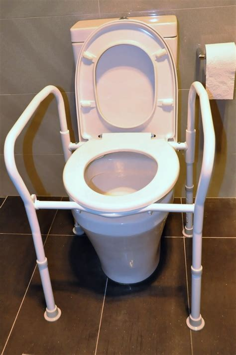 bathroom aids for seniors overtoilet aid folding with splash guard for elderly