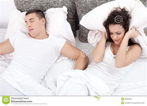 how to be good in bed for women snoring man and young woman couple sleeping in bed stock