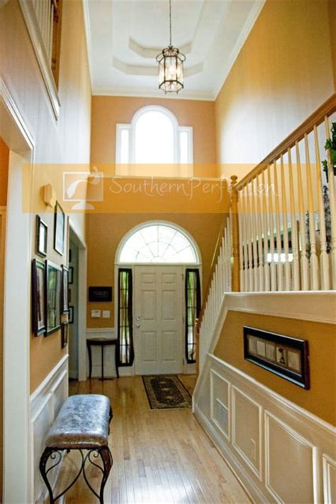 narrow hallways look wider with surface walls in light warm colors such as yellow and