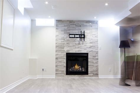 How High Should You Hang A Picture basement fireplaces high tech renovation