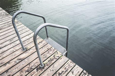 swimming pontoon swimming pontoon with ladder at lake free stock photo