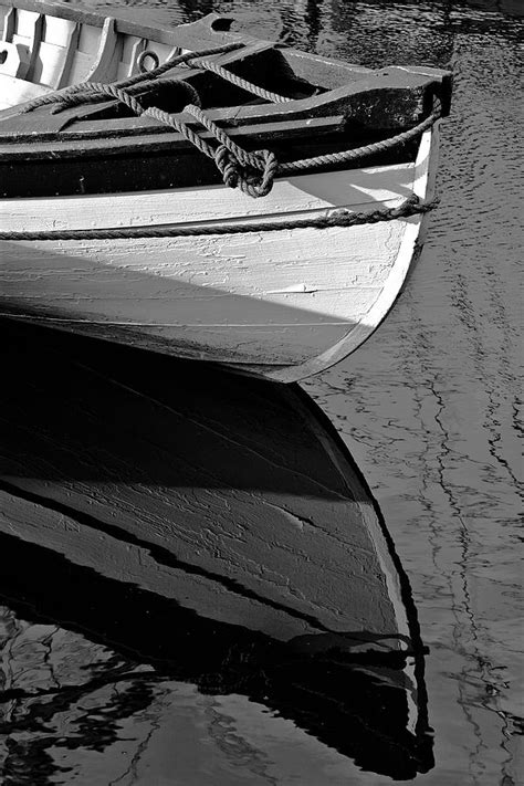 wooden boat bow whaleboat bow reflection photograph by stephen sisk