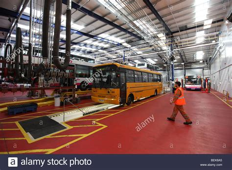 stock photo company inside the workshop at the transport company first bus