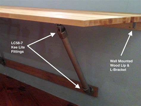 Diy Wall Mounted Folding Table by Wall Mounted Butcher Block Table Supported With Pipe
