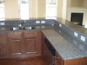 superb Granite Counters With White Cabinets #1: caledonia-granite-countertops2.jpg