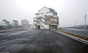 road built around building as refuse to move in