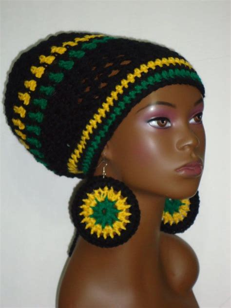 who is the big breasted black woman in liberty commercials jamaica themed crochet tam hat cap with earrings and