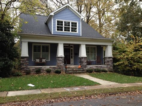 blue bungalow with stacked columns front porch ideas columns of and so