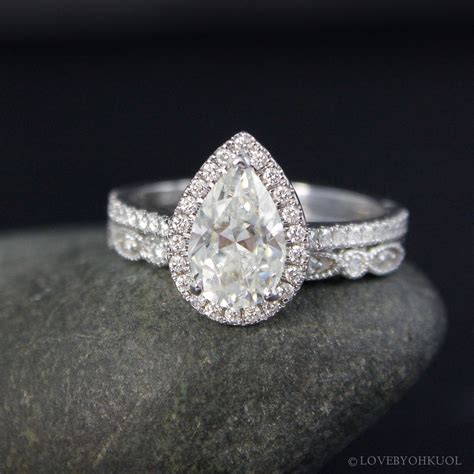 forever one white gold vintage pear cut moissanite halo