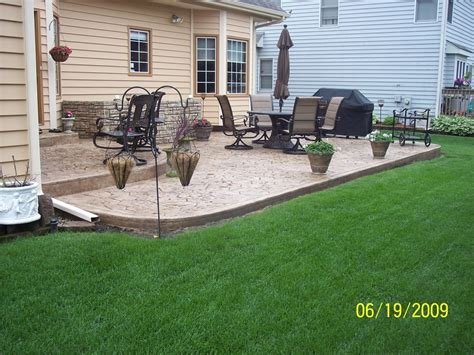 2 tier patio with step and stairs concrete wall with
