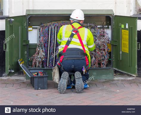 a bt openreach telecommunications technician working on an