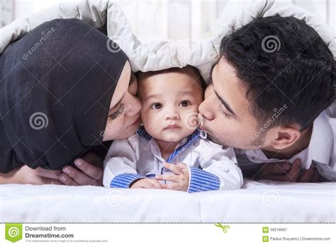 laying in bed in spanish happy beautiful hispanic baby boy relaxing stock image