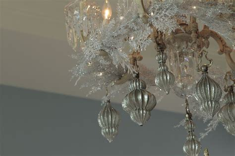 swinging from a chandelier swinging chandelier ornaments christmas pinterest