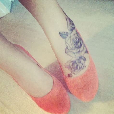 rose tattoo on foot foot tattoos