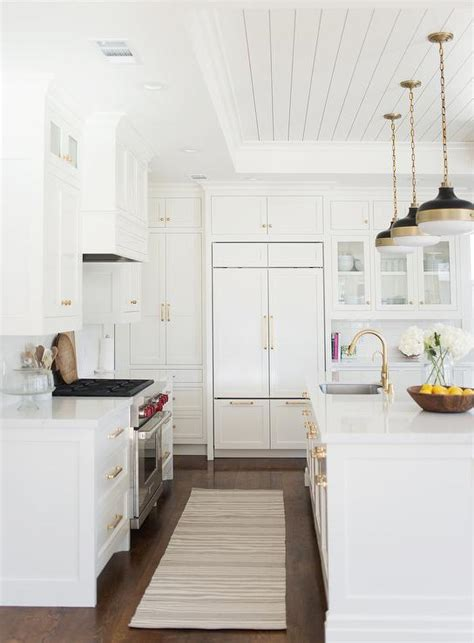 cambria torquay quartz traditional kitchen ikea fans white kitchen features white shaker cabinets paired with