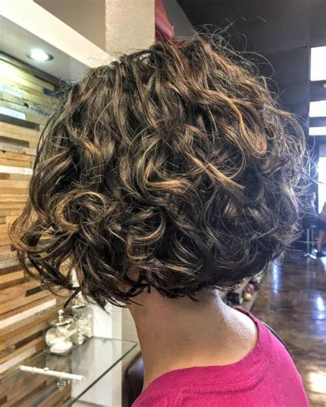 when naturally curly hair shorter in back this is a short layered naturally and curly bob