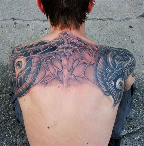 upper back tattoo bio mechanical viking on upperback