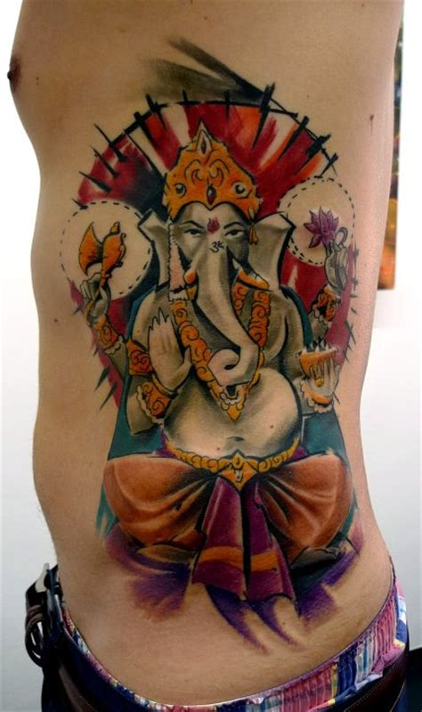ganesha tattoo ribs black ink real heart tattoo on man right side rib