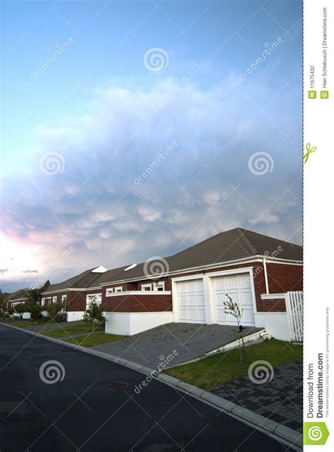 dramatic modern house by site modern house with dramatic clouds stock photography