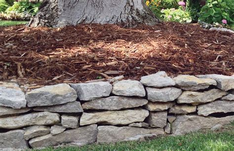 choosing the best landscape bed edging for your client turf