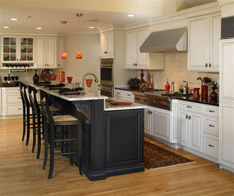 white cabinets with black kitchen island decora