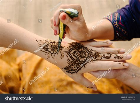 find henna tattoo artist artist applying henna on stock photo