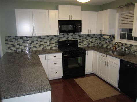 kitchen pics with white cabinets white shaker kitchen cabinets spotlats