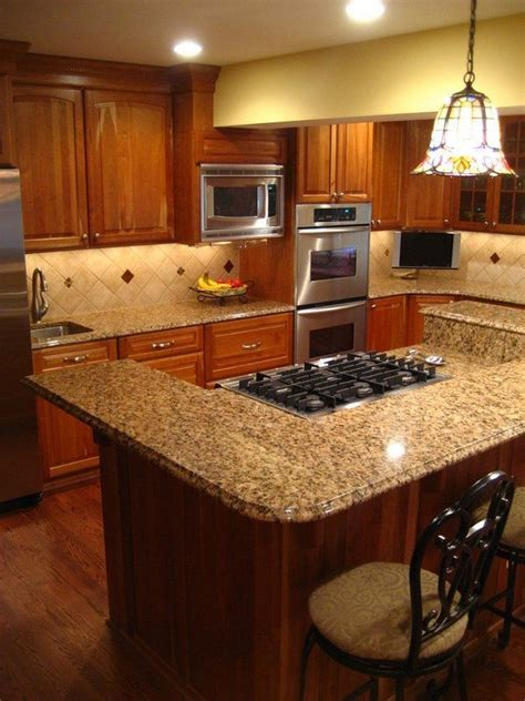dark cabinets  venetian gold granite countertops