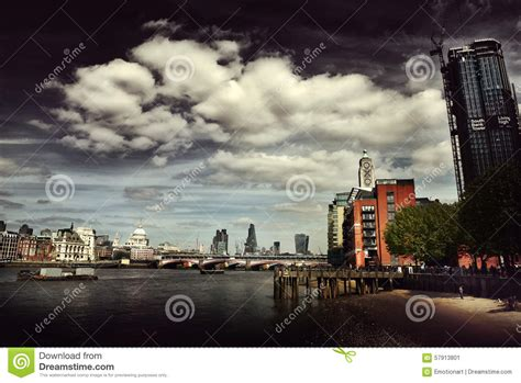 river thames journey times dark moody view of the london city skyline editorial photo