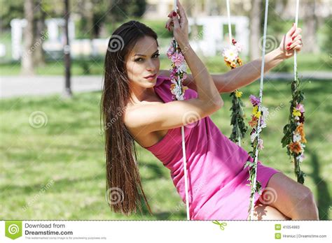 lady swings sexy pink purple dress lady on a swing stock photo