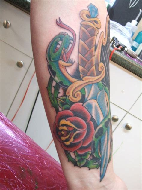 snake and rose tattoo meaning dagger and dagger with snake and