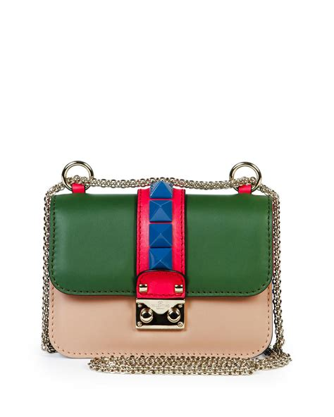 four color valentino resort 2016 bag collection featuring superheroes