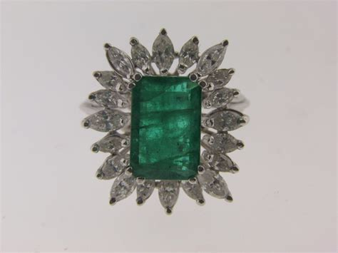 vintage emerald and estate ring in 14k white gold