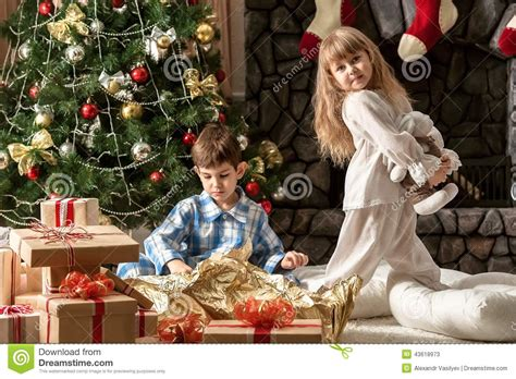 how to dismantle a christmas tree children in the morning the tree dismantled gifts stock photo image 43618973