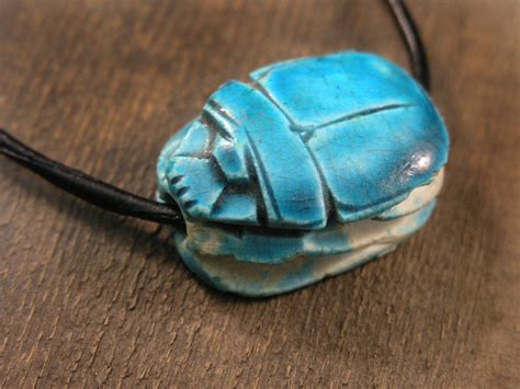 vintage turquoise scarab beetle necklace on a black
