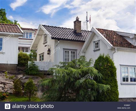 norway buy house idyllic narrow streets and white wooden paneled houses drobak norway stock photo