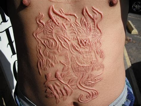 30 unique scarification tattoos designs