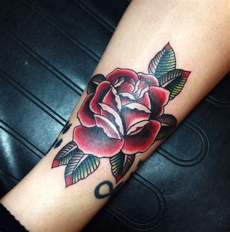 deep red rose tattoo traditional by andy revenant