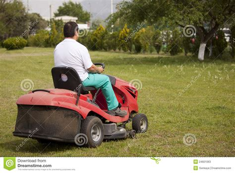 cutting grass games with a lawnmower lawn mower cutting grass stock photos image 24601063