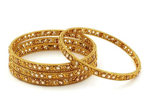 Gold and Diamond jewellery designs: bridal Gold Bangles